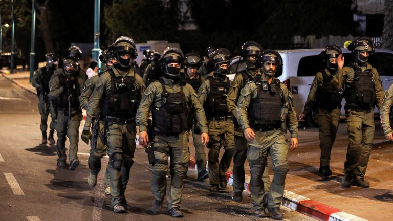 Israeli security force members patrol during a night-time curfew following violence in the Arab-Jewish town of Lod, Israel May 12, 2021