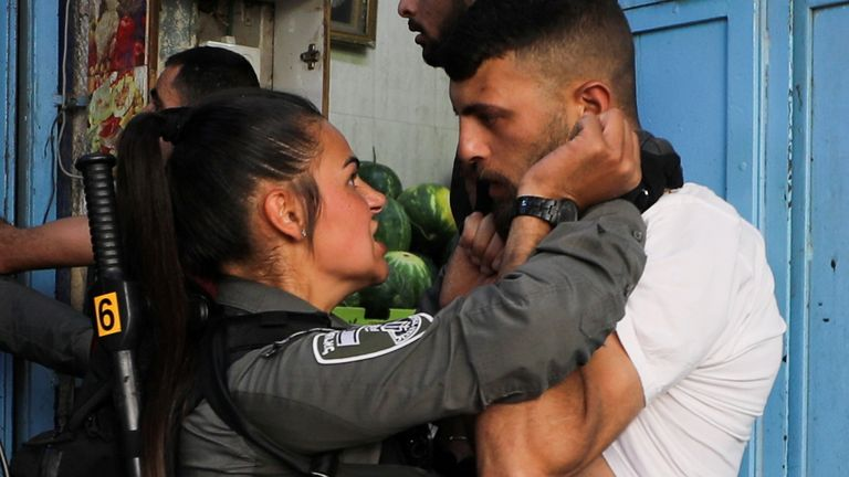 An Israeli security force member holds a protestor during a demonstration held at Damascus Gate