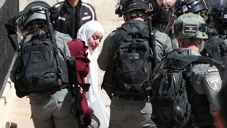 Security forced to detain a Palestinian women during the demonstration just outside Jerusalem's Old city