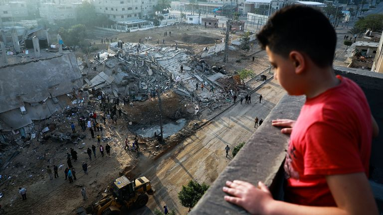 A Palestinian boy looks at ruins of buildings which were destroyed in Israeli air strikes in the northern Gaza Strip. Pic:  Majdi Fathi/NurPhoto/Shutterstock