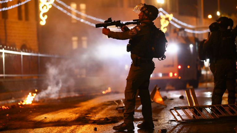 An Israeli police officer during clashes with Palestinians at Damascus Gate just outside Jerusalem's Old City. Pic: AP