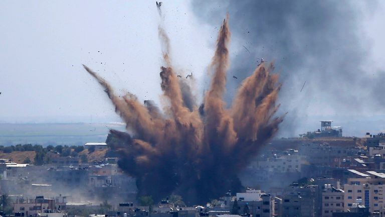 Smoke rises following Israeli airstrikes on a building in Gaza City. Pic: AP