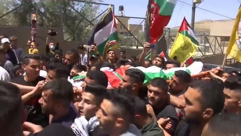 A large crowd of mourners  joined the funeral procession for a 16-year-old Palestinian youth who was killed by Israeli gunfire.