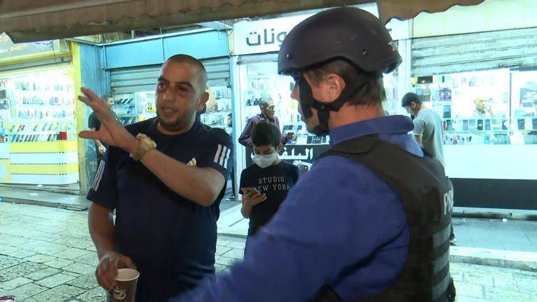 Physiotherapist Ahmad Farrah in Jerusalem talking to Mark Stone