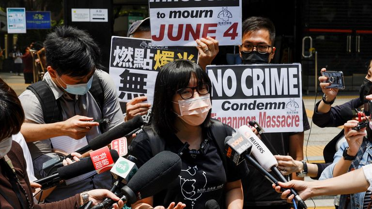 Chow Hang-tung, from the Hong Kong Alliance in Support of Patriotic Democratic Movements of China, speaks to reporters after Mr Wong was sentenced
