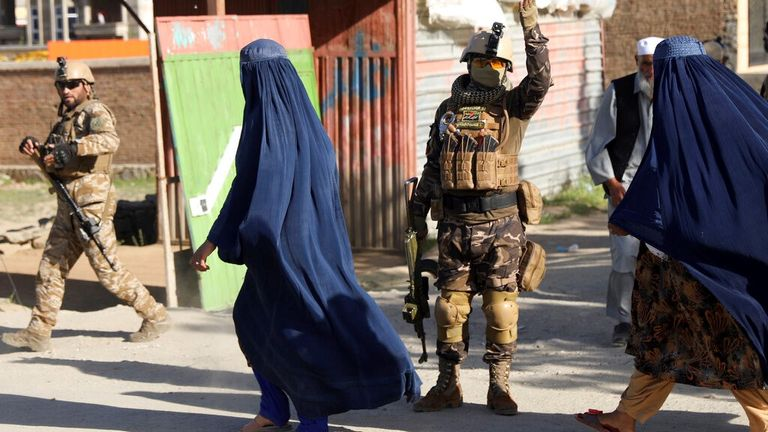 Security personnel arrive at the explosion site in Kabul Pic: AP