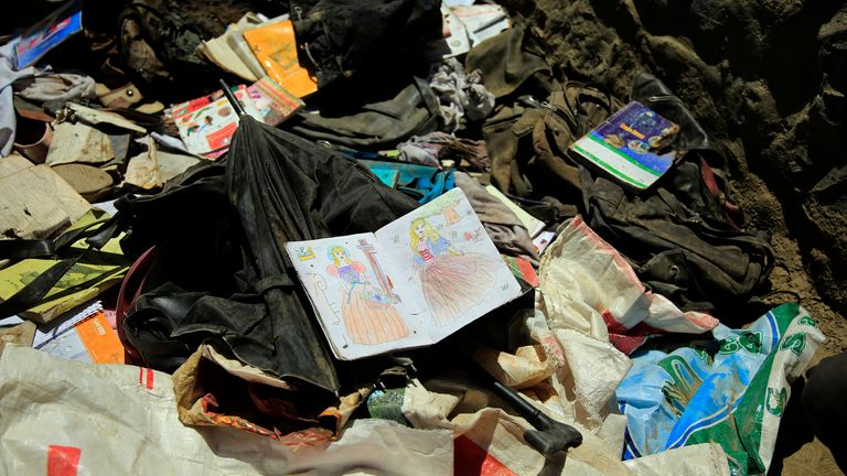 books and notebooks of students are seen on the ground after on Saturday near a school, west of Kabul, Afghanistan, Sunday, May 9, 2021. The Interior Ministry said the death toll in the horrific bombing at the entrance to a girls' school in the Afghan capital has soared to some 50 people, many of them pupils between 11 and 15 years old, and the number of wounded in Saturday...s attack has also climbed to more than 100. (AP Photo/Mariam Zuhaib)..