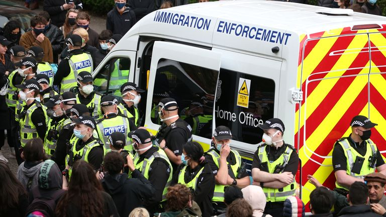 Police surrounded a Home Office van as protesters gathered around