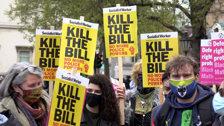 Protesters carry placards with the words 'Kill the bill' and Black Lives Matter at the central London demonstration