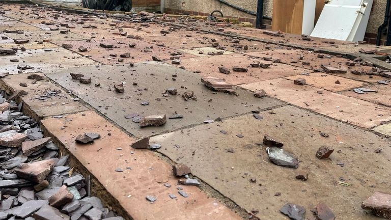 Roof tiles and other debris 'rained down vertically on us,' a local man said