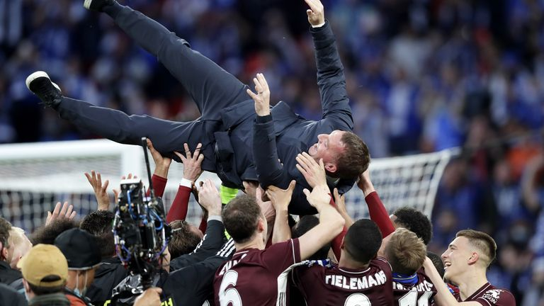 Leicester City manager Brendan Rodgers is thrown into the air as his players celebrate the win