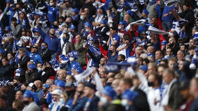 Leicester City fans cheer on their side from the stands