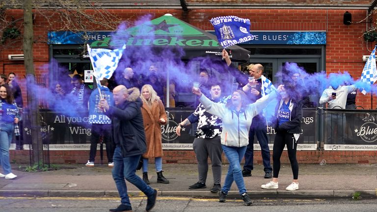 Leicester City fans celebrate victory outside the King Power Stadium in Leicester