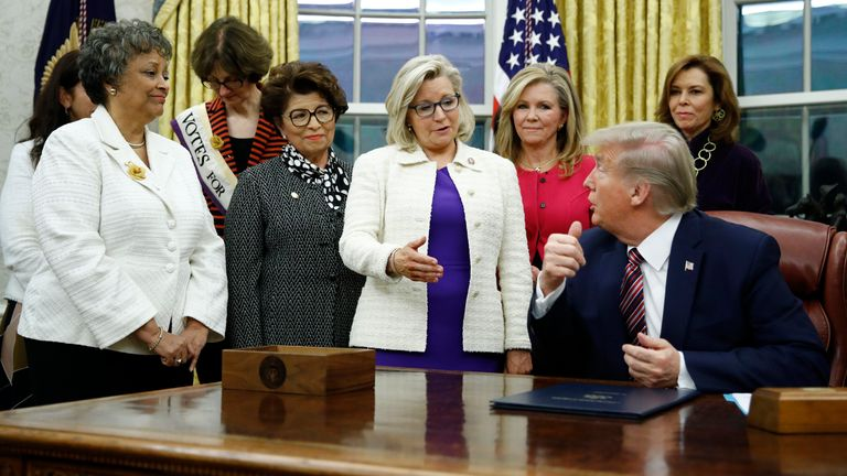 Liz Cheney, in the purple dress, has been a vocal critic of Donald Trump. Pic: Associated Press