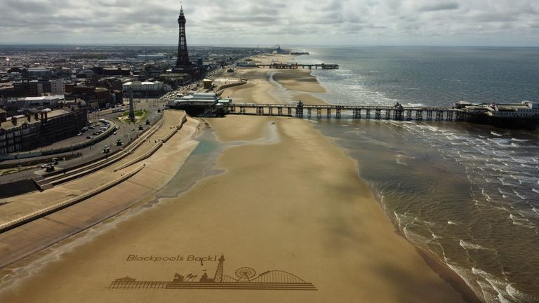 Sand art on the beach at Blackpool, where indoor attractions, hotels and guesthouses, show venues, and indoor hospitality has reopened