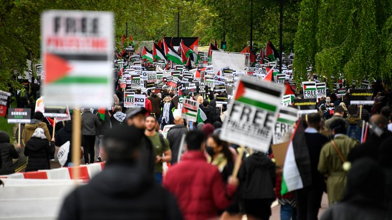 People hold placards and Palestine flags as they march to protest against Israeli attacks on Palestinians in Gaza, in London, Saturday, May 15, 2021.(AP Photo/Alberto Pezzali)