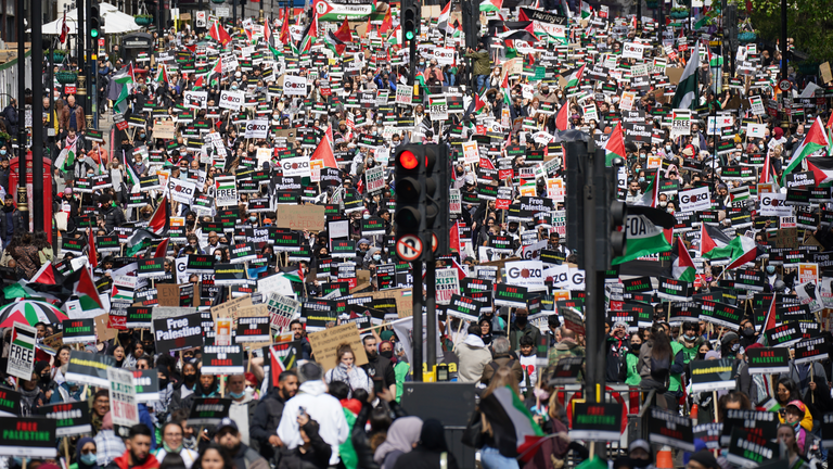 Protesters walk along Piccadily in central London, during a march in solidarity with the people of Palestine, following a ceasefire agreement between Hamas and Israel. Picture date: Saturday May 22, 2021.