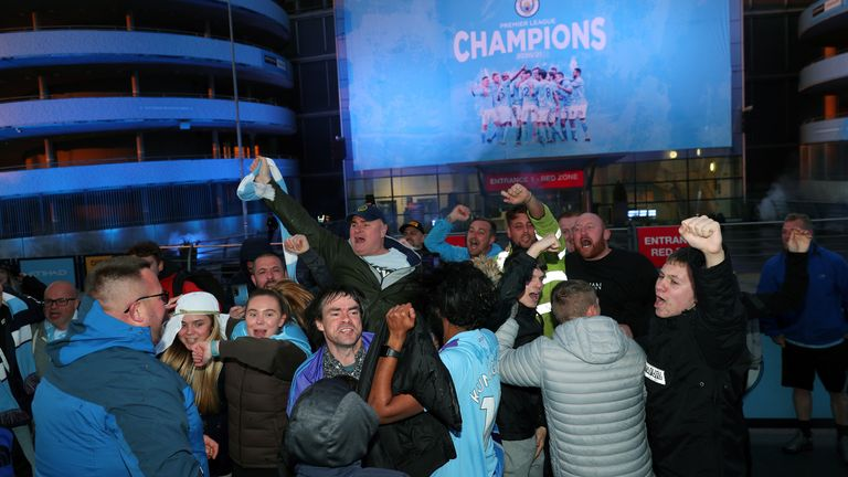 Manchester City fans celebrate at the Etihad Stadium, after Manchester City were crowned Premier League champions following Manchester Unite's home defeat to Leicester. Picture date: Tuesday May 11, 2021.