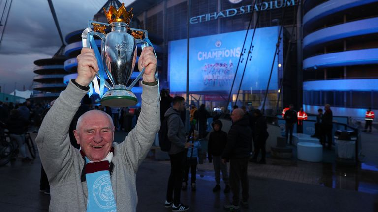 Manchester City fan Tommy Muir celebrates at the Etihad Stadium, after Manchester City were crowned Premier League champions following Manchester United�s home defeat to Leicester. Picture date: Tuesday May 11, 2021.