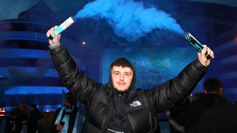 Manchester City fans celebrate at the Etihad Stadium, after Manchester City were crowned Premier League champions following Manchester United's home defeat to Leicester. Picture date: Tuesday May 11, 2021.