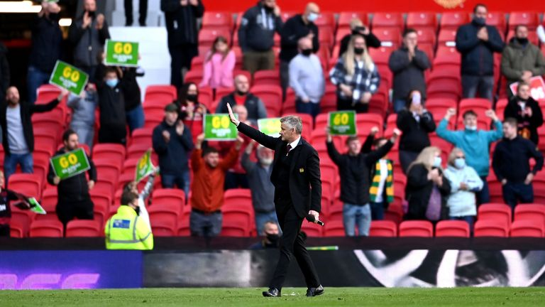 Manchester United manager Ole Gunnar Solskjaer gestures to the fan after the Premier League match at Old Trafford, Manchester. Picture date: Tuesday May 18, 2021.