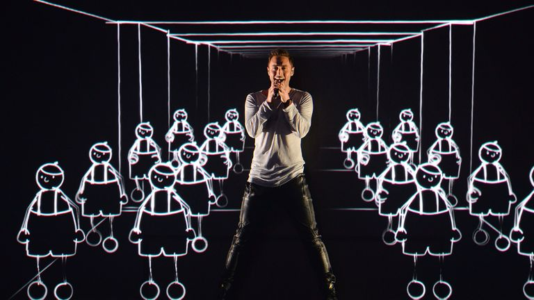 FILE - In this Wednesday, May 20, 2015 file photo, Sweden's Mans Zelmerlow performs the song 'Heroes' during a dress rehearsal for the second semifinal of the Eurovision Song Contest in Austria's capital Vienna. Zelmerlow won the competition last year with a performance featuring animated dancers. His victory means that Sweden is hosting this year's event, the final of which is due to take place in the capital Stockholm on Saturday, May 14. (AP Photo/Kerstin Joensson, File)