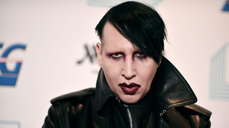 """FILE - In this Dec. 10, 2019, file photo, Marilyn Manson attends the 9th annual """"Home for the Holidays"""" benefit concert in Los Angeles. Detectives are investigating Manson for allegations of domestic violence that reportedly occurred about a decade ago in West Hollywood, authorities said. The domestic violence is believed to have occurred between 2009 and 2011, when Manson lived in the city of West Hollywood. (Photo by Richard Shotwell/Invision/AP, File)"""