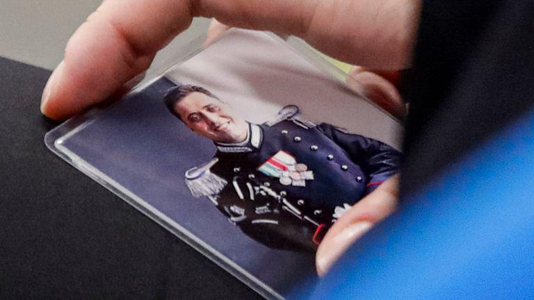 Rosa Maria Esilio, widow of Italian Carabinieri paramilitary police officer Mario Cerciello Rega, holds a photograph of her husband Pic: AP