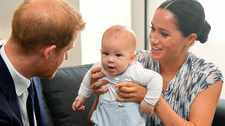 File photo dated 25/09/2019 of the Duke and Duchess of Sussex holding their son Archie during a meeting with Archbishop Desmond Tutu and Mrs Tutu at their legacy foundation in cape Town, on day three of their tour of Africa. Meghan and Harry will celebrate the second birthday of their son, who helped inspire his mother???s new picture book. Issue date: Thursday May 6, 2021.