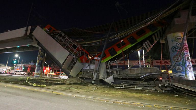 The train split in two when the overpass collapsed. Pic: AP