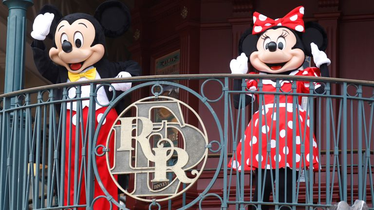 Mickey Mouse and Minnie welcome visitors to Disneyland Paris when it reopened following its closure in the first COVID lockdown, in 2020