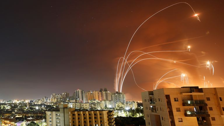 Streaks of light are seen as Israel's Iron Dome anti-missile system intercept rockets launched from the Gaza Strip towards Israel, as seen from Ashkelon, Israel May 12, 2021. REUTERS/Amir Cohen