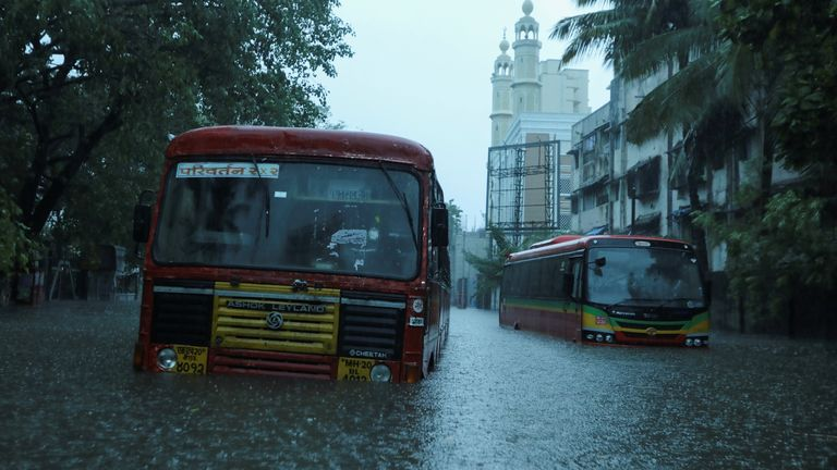 Passenger buses are stranded on a waterlogged road after heavy rains caused by Cyclone Tauktae in Mumbai