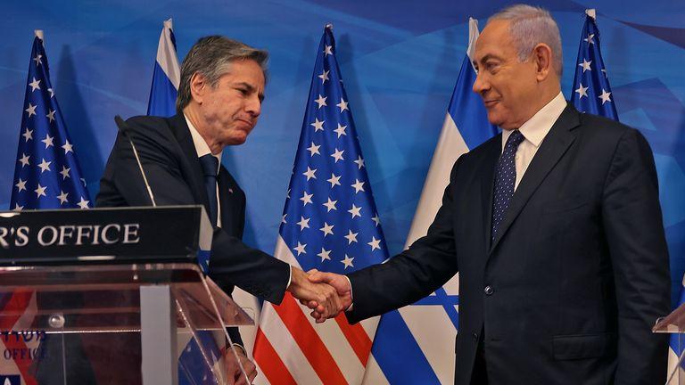 Israeli Prime Minister Benjamin Netanyahu and US Secretary of State Anthony Blinken shake hands