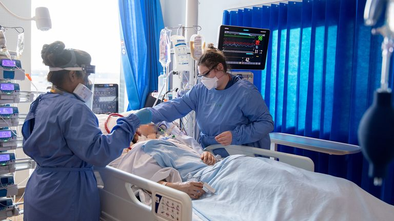 Nurses tend to a patient suffering from COVID-19 in March