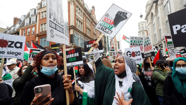 Pro-Palestinian demonstrators attend a protest following a flare-up of Israeli-Palestinian violence, in London, Britain, May 15, 2021. REUTERS/Peter Nicholls