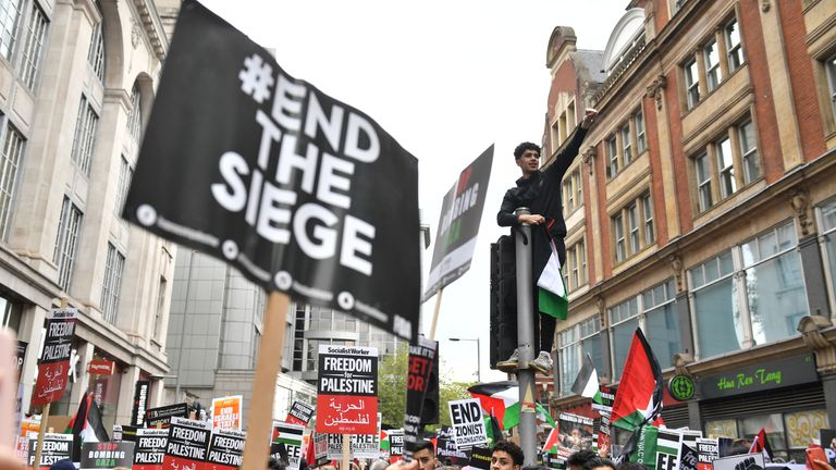 Demonstrators on Kensington High Street, as they protest near to the Israeli embassy in London, during a march in solidarity with the people of Palestine amid the ongoing conflict with Israel. Picture date: Saturday May 15, 2021.