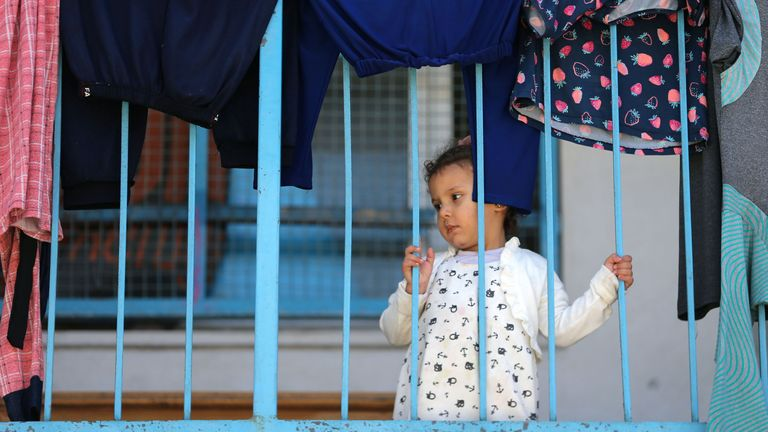 A Palestinian girl who fled her family home takes refuge at a UN-run school