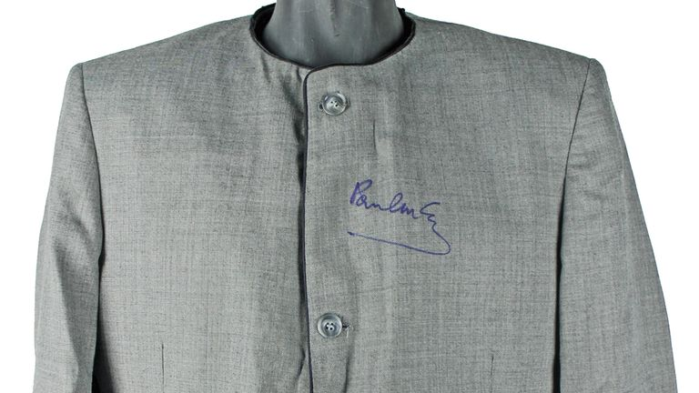 A jacket signed by Paul McCarthy is also listed as one of the items available. Pic Iconic Auctions