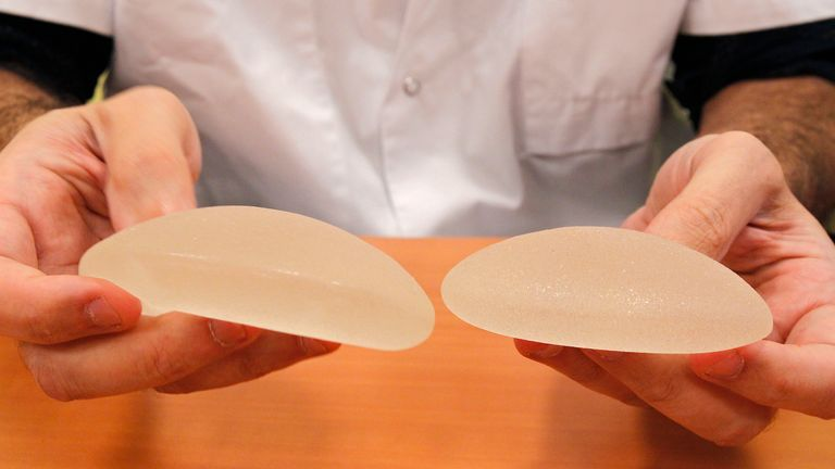 A doctor in the US holds silicone gel breast implants made by French company Poly Implant Prothese, or PIP in 2011. The implants were removed from a patient over safety concerns