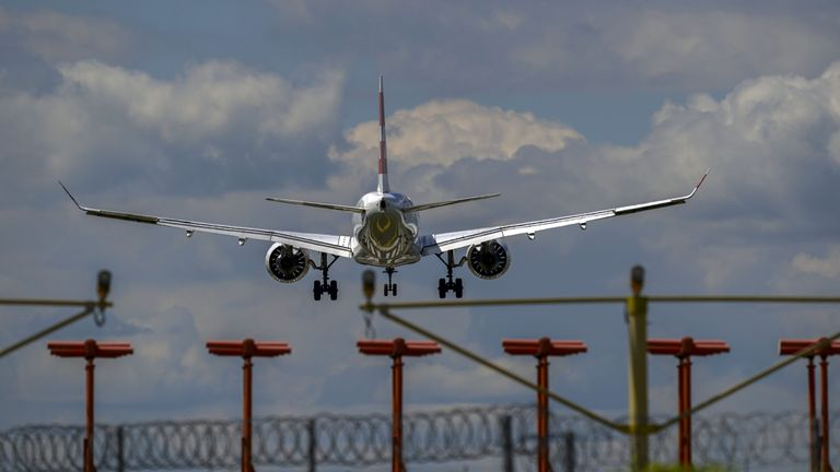 A plane lands at Heathrow Airport