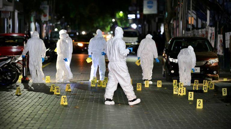 Police examine scene of explosion
