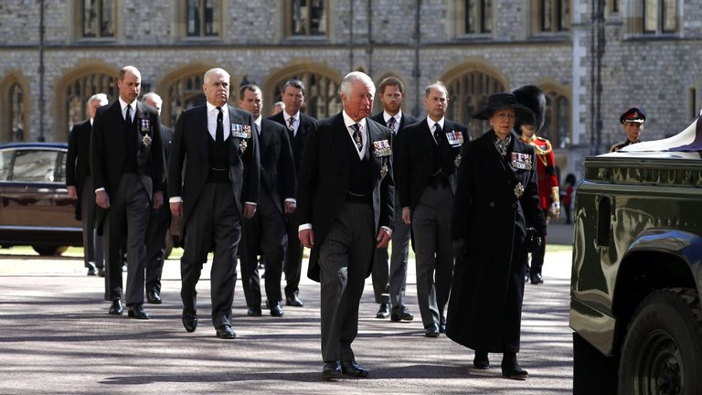 Harry (behind, right) and William (behind, left) were last together at their grandfather's funeral