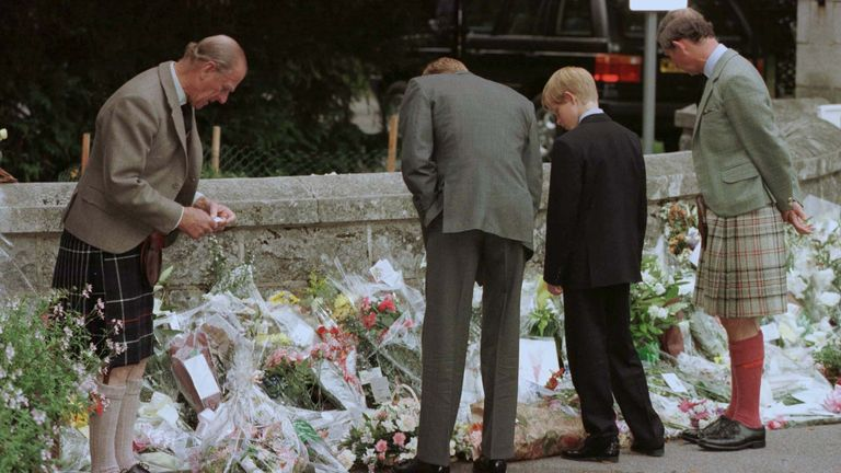 Prince William (2nd left) with Princes Harry, Philip and Charles viewing floral tributes to his mother at Balmoral after her death