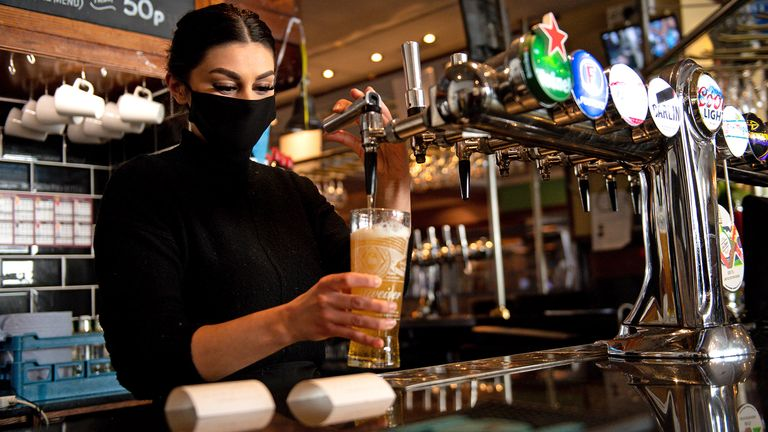 Bar staff pour drinks at the reopening of the Figure of Eight pub, in Birmingham, as England takes another step back towards normality with the further easing of lockdown restrictions. Picture date: Monday April 12, 2021.
