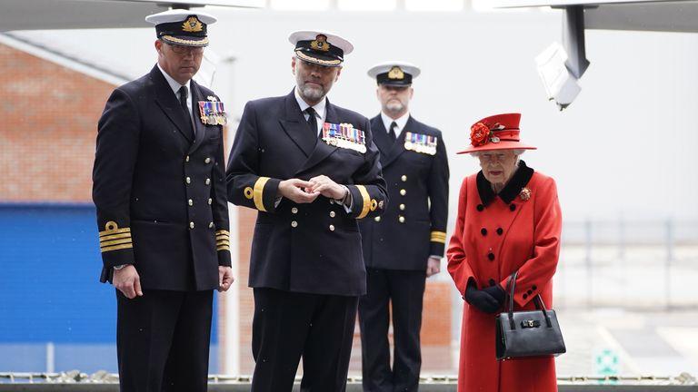 The Queen met Captain Angus Essenhigh (left) and Commodore Steve Moorhouse onboard the  HMS Queen Elizabeth