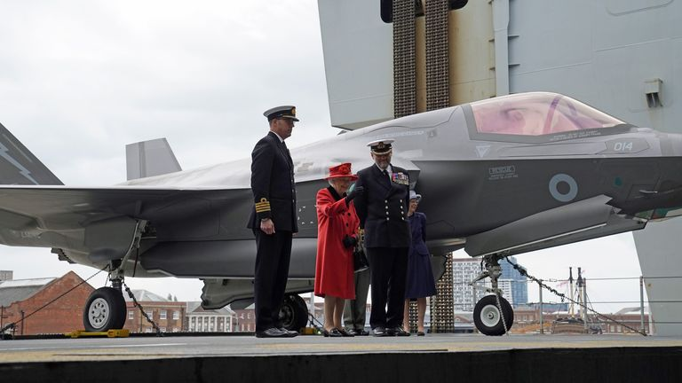 The Queen on the ship's flight deck