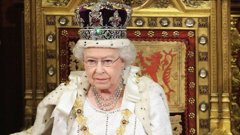 Queen Elizabeth waits to read the Queen's Speech to lawmakers in the House of Lords during the State Opening of Parliament in central London May 9, 2012