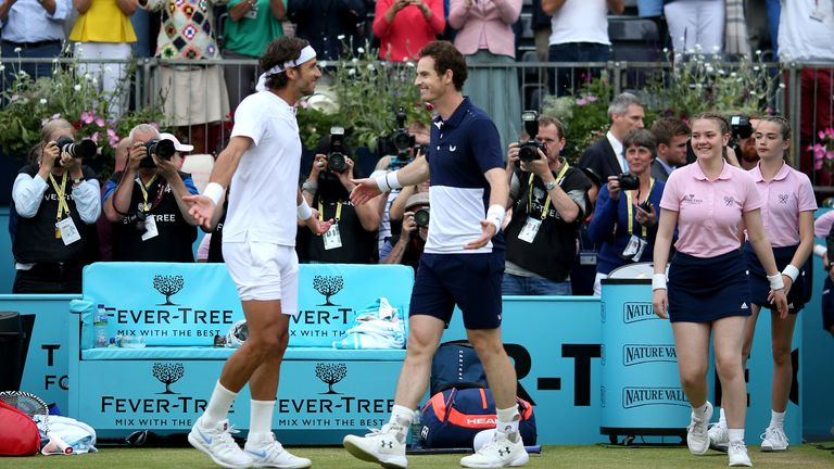 Feliciano Lopez (left) and Andy Murray (right) celebrate victory in the Men's Doubles final during day seven of the Fever-Tree Championship at the Queen's Club, London. PRESS ASSOCIATION Photo. Picture date: Sunday June 23, 2019. See PA story TENNIS Queens. Photo credit should read: Steven Paston/PA Wire. RESTRICTIONS: Editorial use only, no commercial use without prior permission.