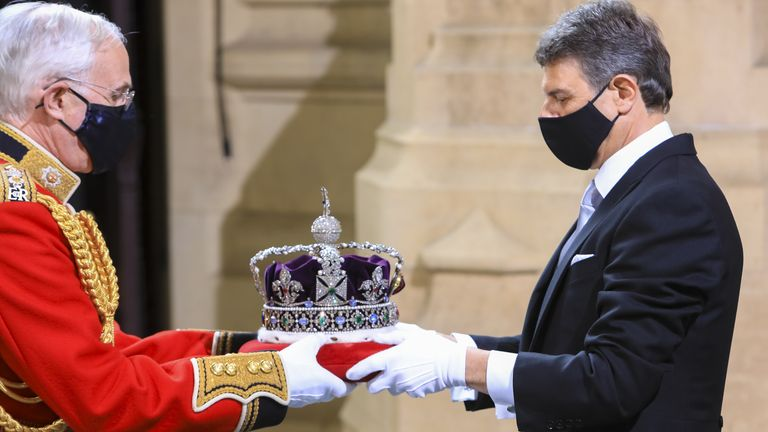 The Imperial State Crown arrives at the Sovereign's Entrance to the Palace of Westminster ahead of Queen Elizabeth II delivering a speech from the throne to outline the government's legislative programme for the coming session during the State Opening of Parliament. Picture date: Tuesday May 11, 2021.